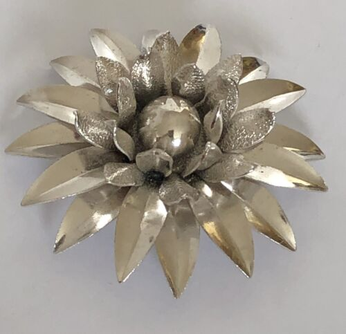 Coro vintage silver tone metal flower pin with black and clear crystals