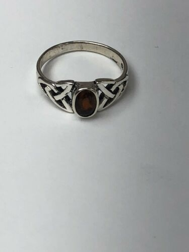 # 1128 Celtic sterling silver garnet ring square face