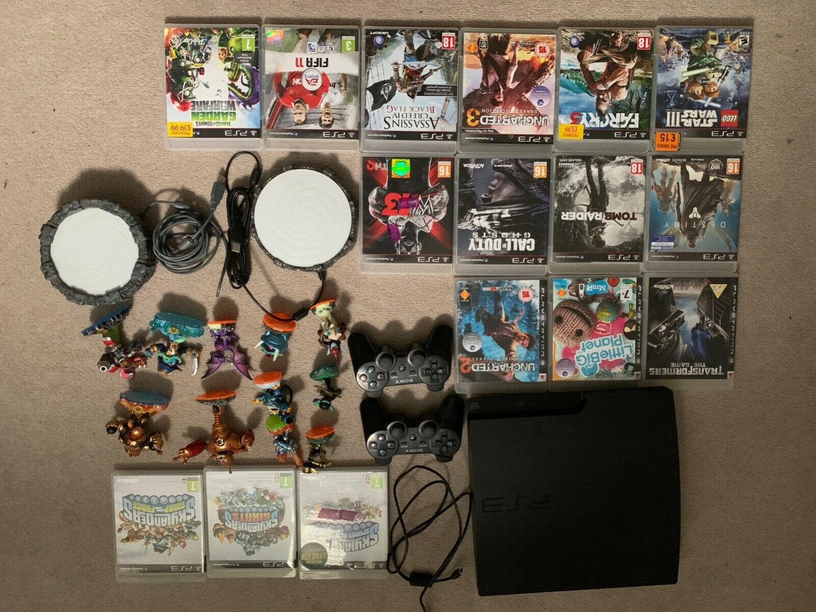 ps3 console in good working condition with 16 games and two remotes
