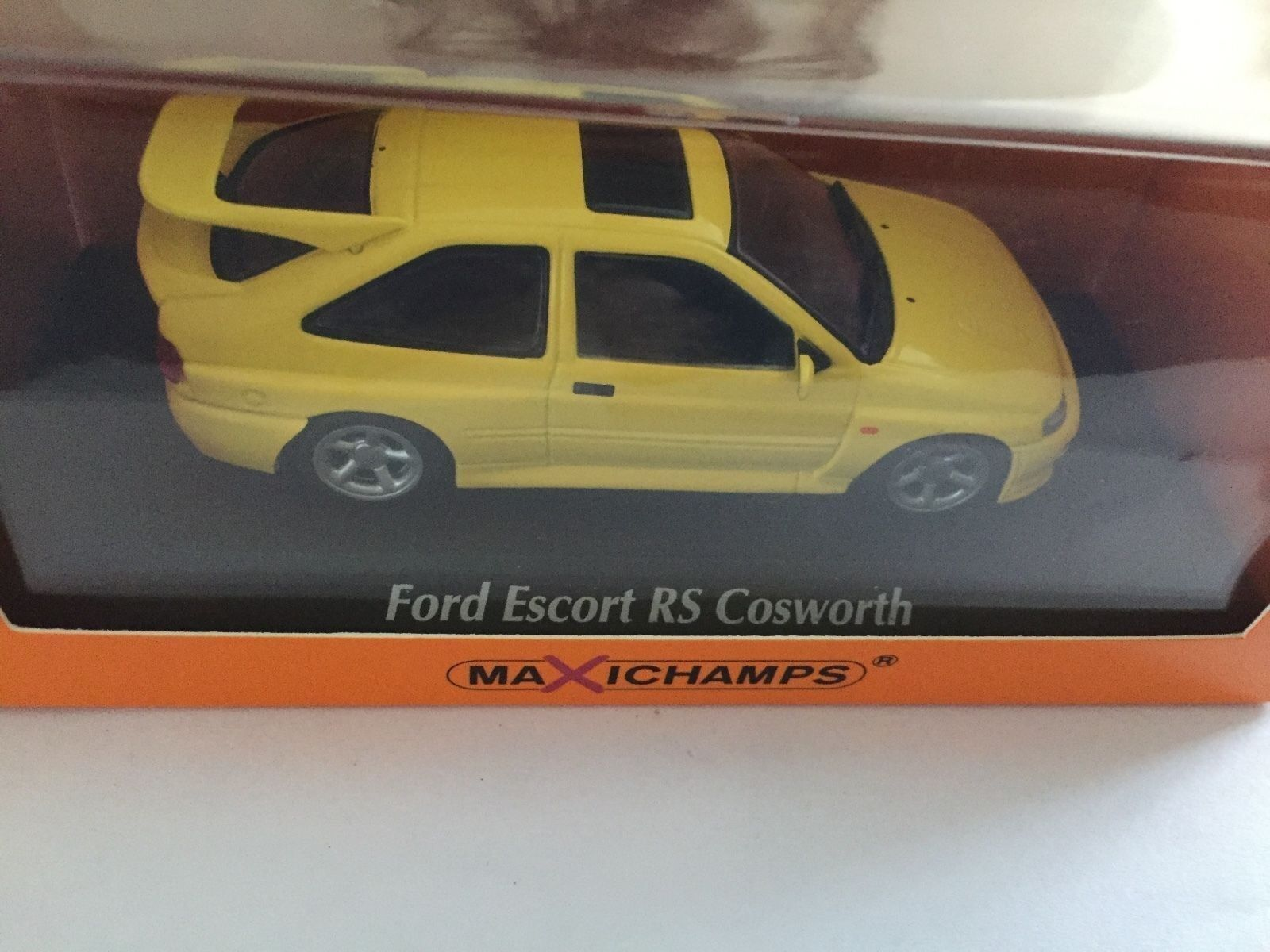 Ford Escort RS Cosworth 1992 Yellow Maxichamps 940 082101 1 43 diecast model