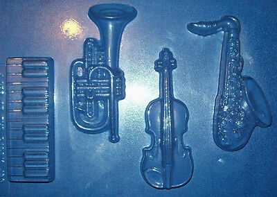 FOUR ASSORTED MUSICAL INSTRUMENT SHAPES CHOCOLATE MOULD - EUC