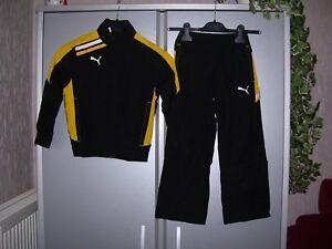 Details zu Puma Kinder Trainingsanzug Esito Woven Jogginganzug gelb schwarz 116 od. 164 neu