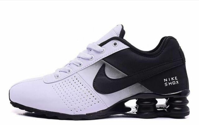 site réputé f3c06 af328 MENS BLACK AND WHITE NIKE SHOX ATHLETIC RUNNING SHOES SIZES 7-11