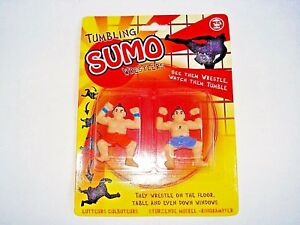 * FUN 'TUMBLING SUMO WRESTLERS' They wrestle on the floor,table and down windows