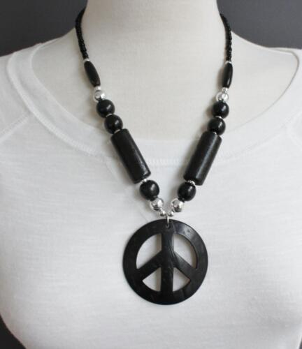60s -70s Jewelry – Necklaces, Earrings, Rings, Bracelets   Black peace sign necklace 20 long plastic wood beads necklace $9.99 AT vintagedancer.com
