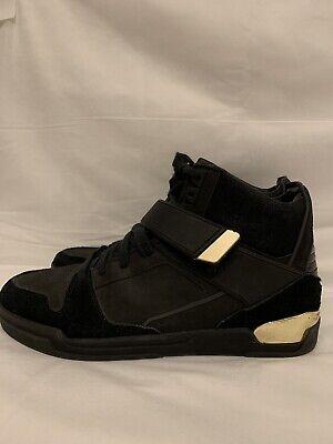 Zara man black sneakers with gold.Still