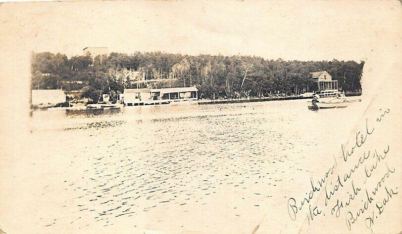 Birchwood ND Fish Lake Boats Hotel in Distance Real Photo Postcard