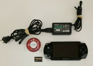 Sony PSP-1001 Handheld Console (Black), Charger, 1GB Memory, & Namco Museum Game