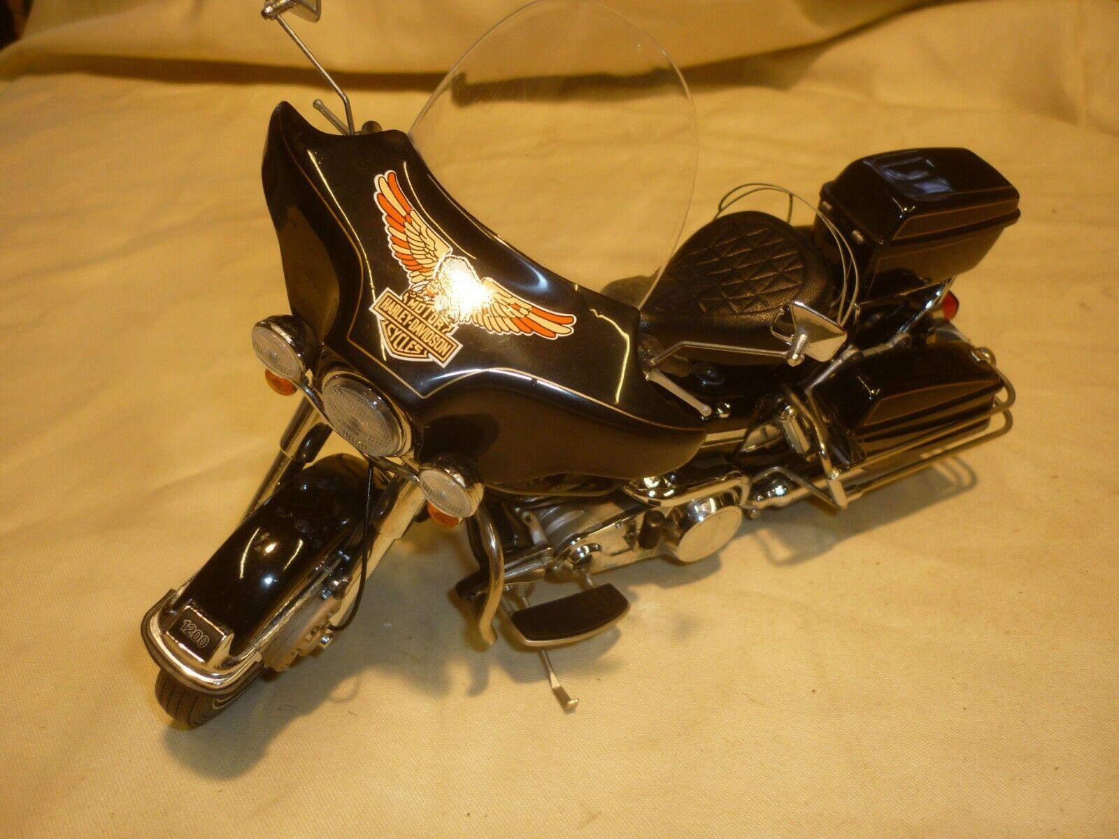 A Franklin  mint of a scale model of a Harley Davidson Electra glide,  livraison et retours gratuits