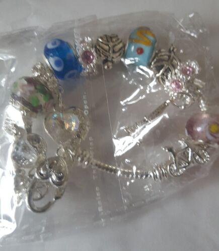 BNIB  beaded charm bracket coloured beads and dangle charms.