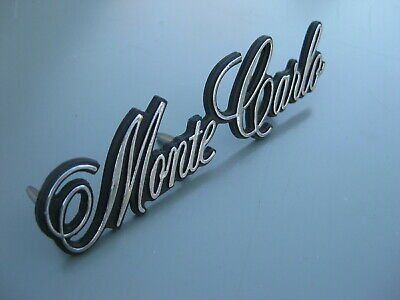 1973-1975 CHEVY Monte Carlo  GM Reproduction NEW Header Panel Nose Emblem USA
