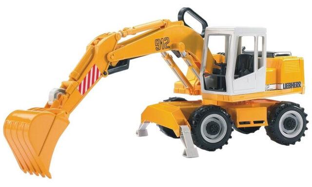 BRU2426 - Excavatrices LIEBHERR sur pneus jouet BRUDER - 1/16