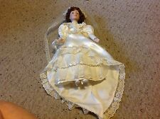 "Baby Doll with Porcelain ? Face, feet and hands.     15""  long.  Bride.  Used."