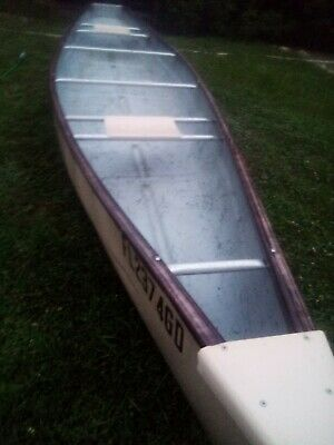16 ft chief fiberglass canoe , was set up with a trolling motor