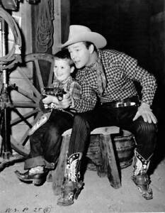 American-Actor-And-Singer-Roy-Rogers-Playing-With-A-Small-Boy-Circa-OLD-PHOTO