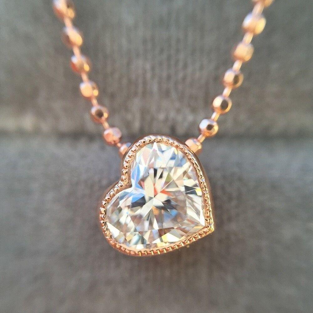 0.46 CARAT F VS2 NATURAL HEART SHAPE DIAMOND BEZEL SET PENDANT 18K pink gold