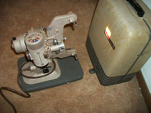 BELL & HOWELL B&H B & H 8MM FILM MOVIE PROJECTOR WITH COVER MAKING NOISES