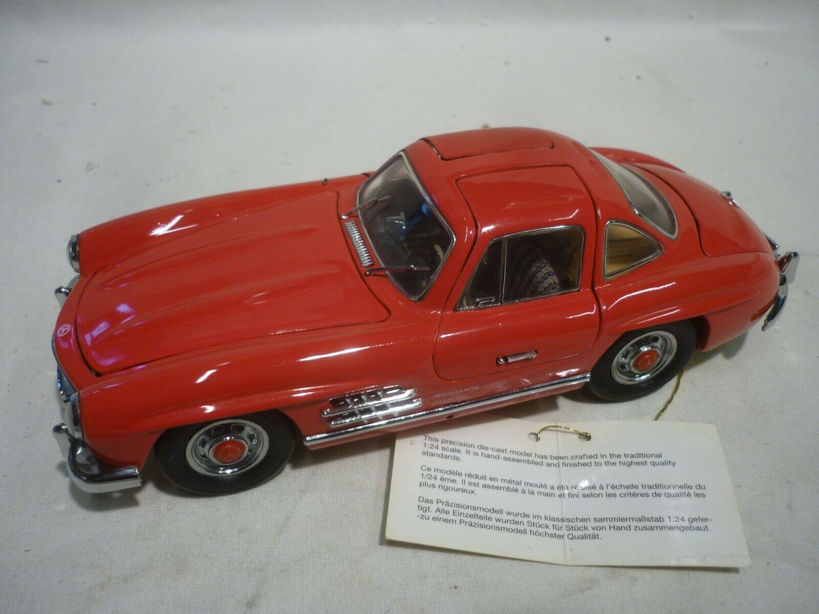A Franklin mint scale model of a 1954 Mercedes Benz 300sl with Gull wing doors