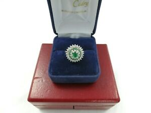 Bague-entourage-diamants-et-emeraudes