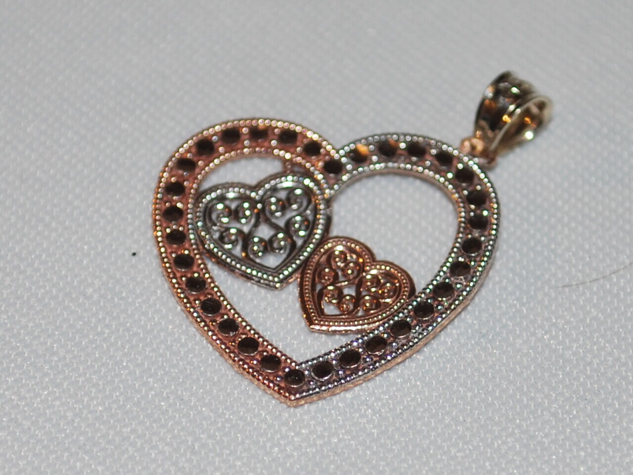10K White and pink gold heart shapes gold pendant