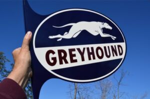 OLD-STYLE-24-034-GREYHOUND-DOG-BUS-LINES-TRAVEL-DICUT-FLANGE-SIGN-MINT-USA-MADE