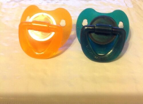 TWO MAGNETIC PACIFIERS TO FIT BABY ALIVE DOLLS SHOWN ORANGE AND PURPLE OR PINK