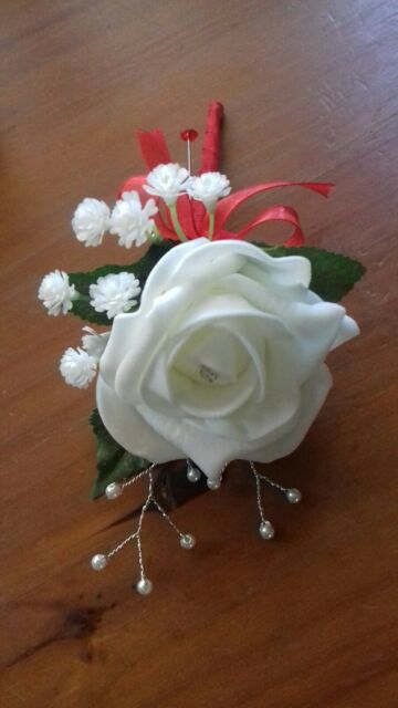 Wedding rose (ivory) buttonholes x 1 gyp, diamante and pearls red ribbon bow