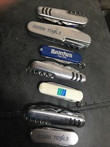Lot of advertising knives (7). All are multi tool/knife. All function well.