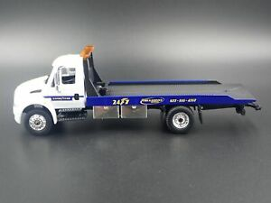 INTERNATIONAL-DURASTAR-FLATBED-TOW-TRUCK-GOODYEAR-1-64-SCALE-DIECAST-MODEL-CAR