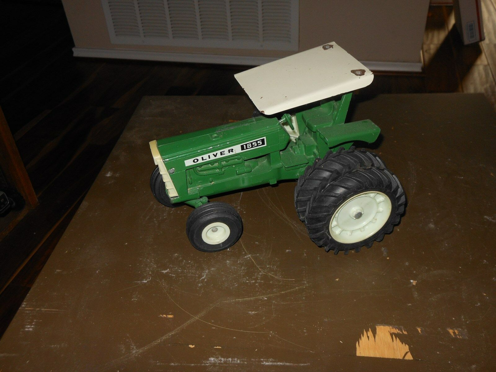Oliver 1855 toy tractor  (bianca, Moline)   duals and ROPS