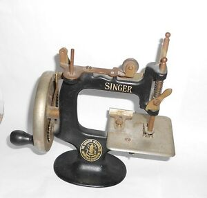 ATTIC FIND: ANTIQUE CAST IRON TOY SEWING MACHINE-A WORKING MINIATURE.