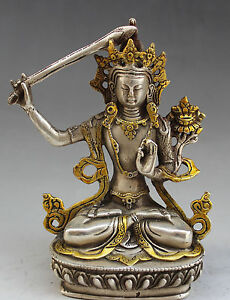 Buddha-hold-sword-collection-of-pure-copper-and-gold-sitting-Buddha-furnishing