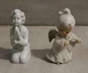 Coppia-di-putti-in-ceramica-soprammobile-arredamento