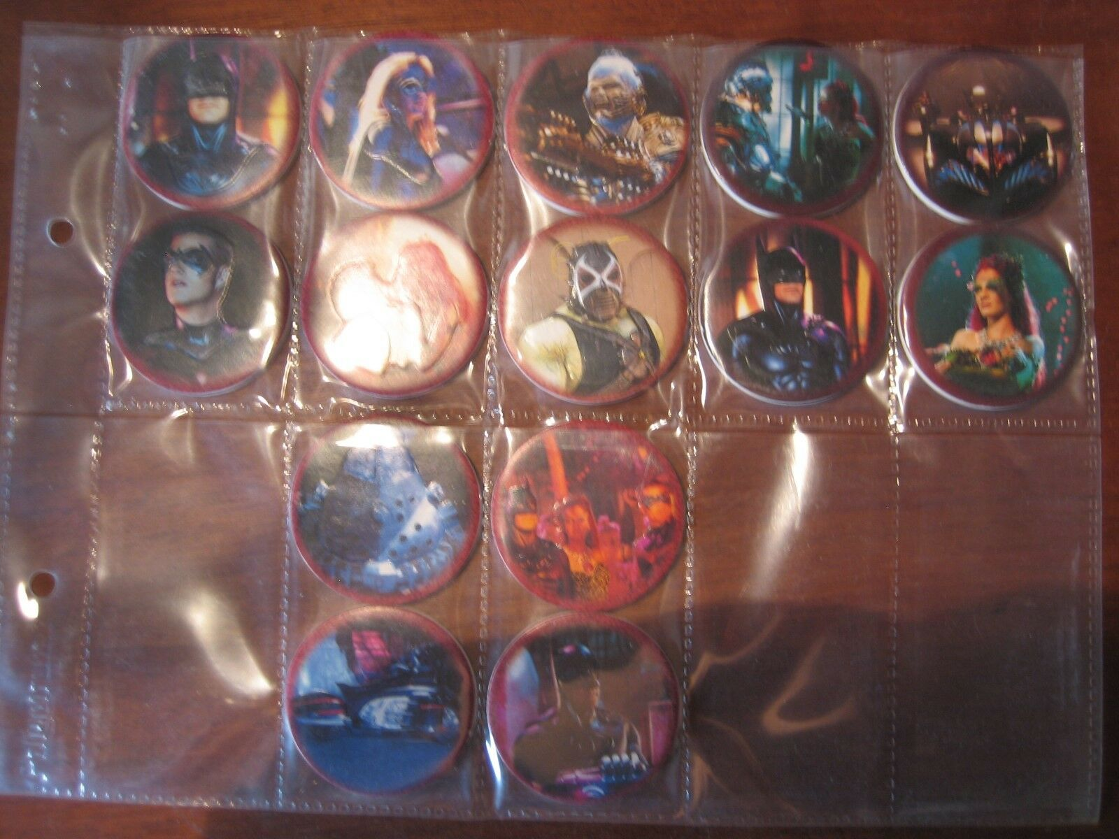 A vintage job lot of 14 X pogs tm &1997 dc comic pogs