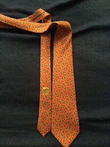 Cravate Hermes en Soie petites Fleurs orange. Très Très Bel État.