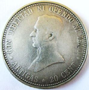 """URUGUAY .1920 .SILVER 20 CENT REPUBLICA ORIENTALE DEL URUGUAY .25 MM - France - Commentaires du vendeur : """"URUGUAY .20 CENT 1920 .ARGENT . DIAMETRE POUR CETTE MONNAIE 25 MM AU + EPAISSEUR 1.2 MM X POIDS 4.77 GRAMMES POUR CETTE MONNAIE ..TOTALEMENT IDENTIQUE AUX SCANS"""" - France"""
