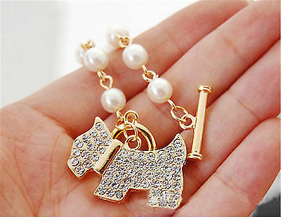 Gold tone crystal dog puppy charm bracelet