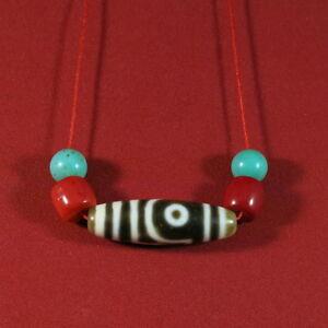 Dzi-deux-yeux-corail-et-turquoise