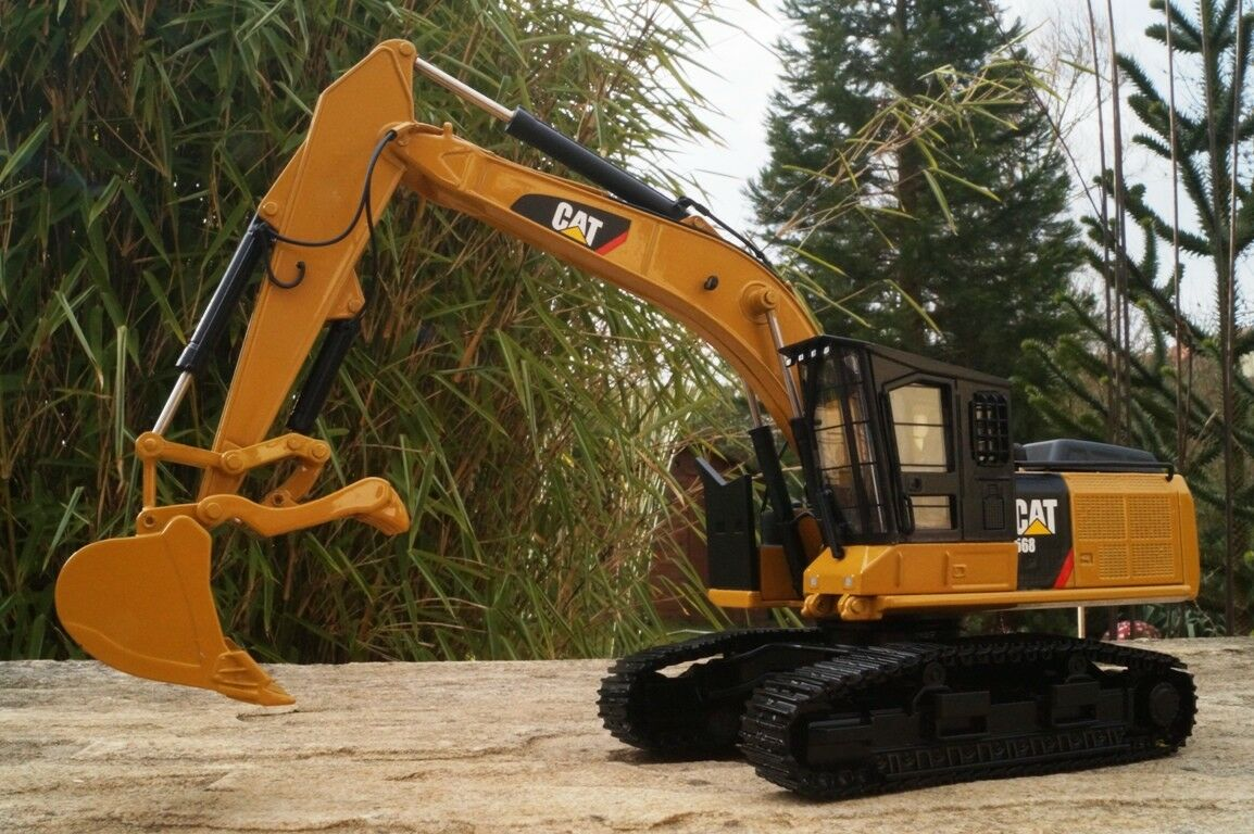 TONKIN 40003 Cat 568gf Road  Excavateurs avec Holzgreifer 1 50 NOUVEAU neuf dans sa boîte  marque célèbre