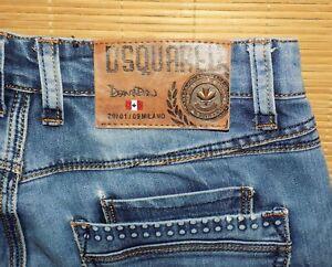 jean vintage DSQUARED2 en coton bleu délavé effets usé taille 31 ou 40 fr
