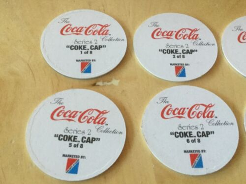 8 Caps 1,2,3,4,5,6,7,8 Series 2. Cardboard Coca Cola Coke Cap Collection