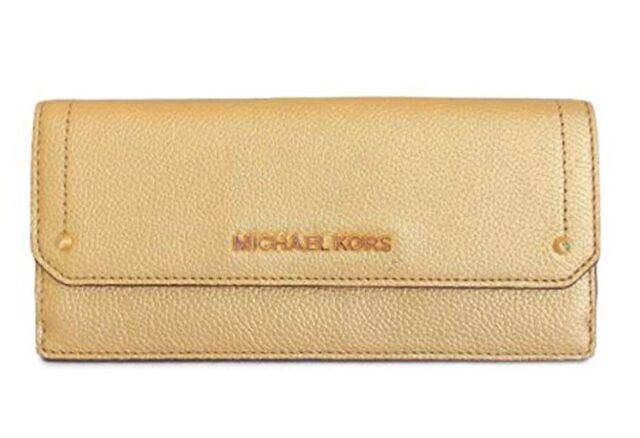 85bcac15f70d NWT MICHAEL KORS METALLIC GOLD PEBBLED LEATHER HAYES FLAT WALLET