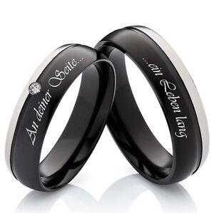 2-Eheringe-Verlobungsringe-aus-Titan-schwarz-mit-Zirkonia-und-Lasergravur-H116