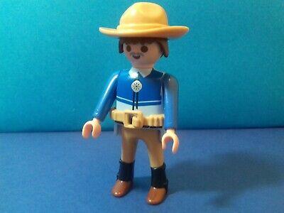 PLAYMOBIL Western Un cow boy chemise bleue et chapeau marron