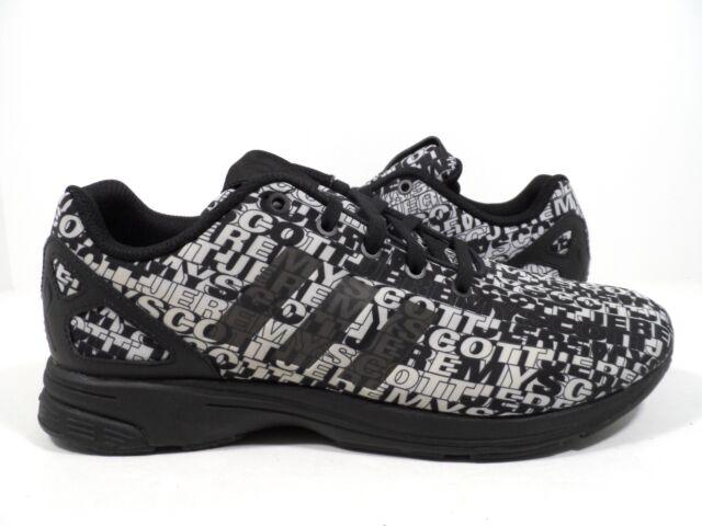 a0c09d1feca9 adidas Originals Mens JS Jeremy Scott ZX Flux Tech Logo Runner Black white 9