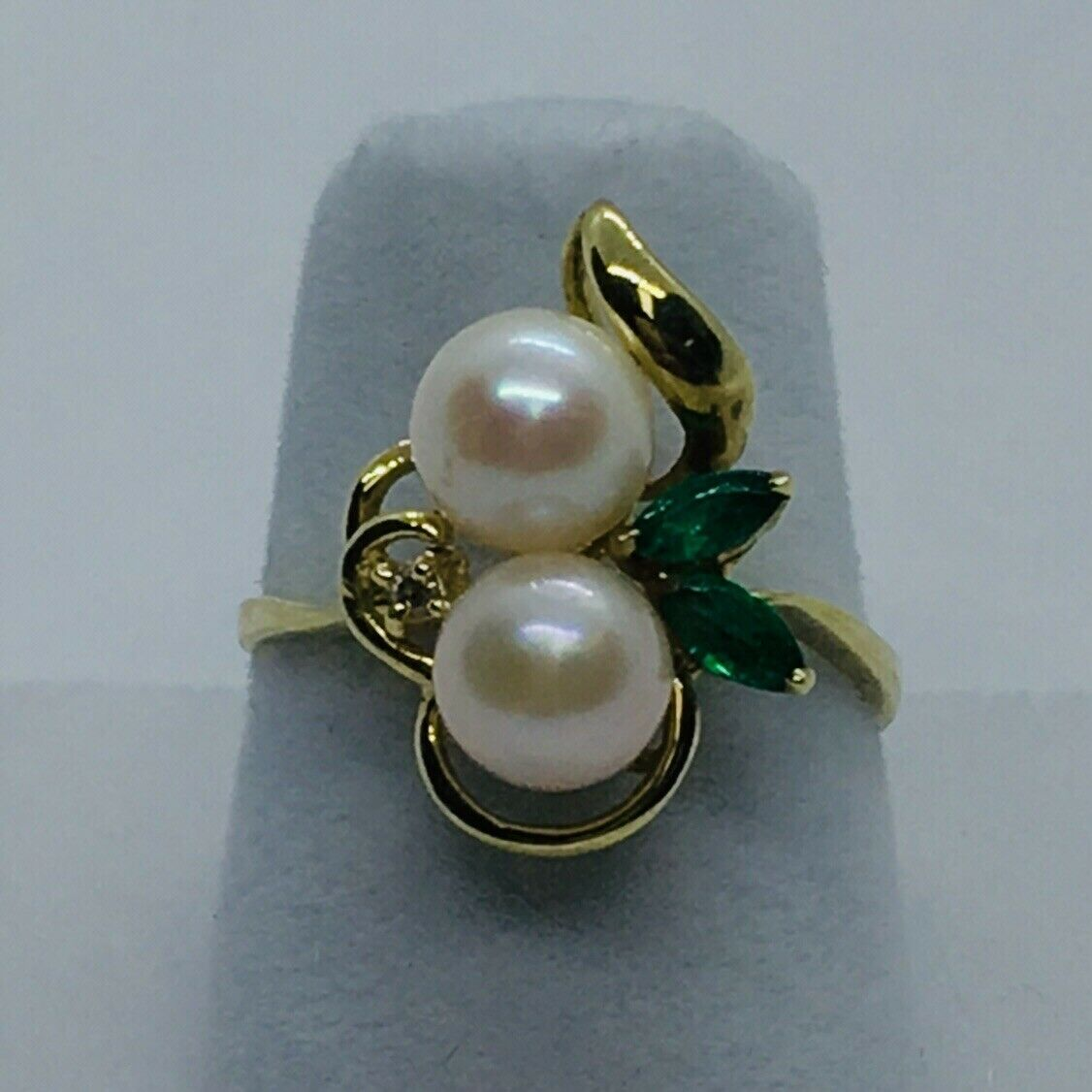 14k gold Ring With 2 6mm Pearls, 2 Marquise Emeralds And A Diamond