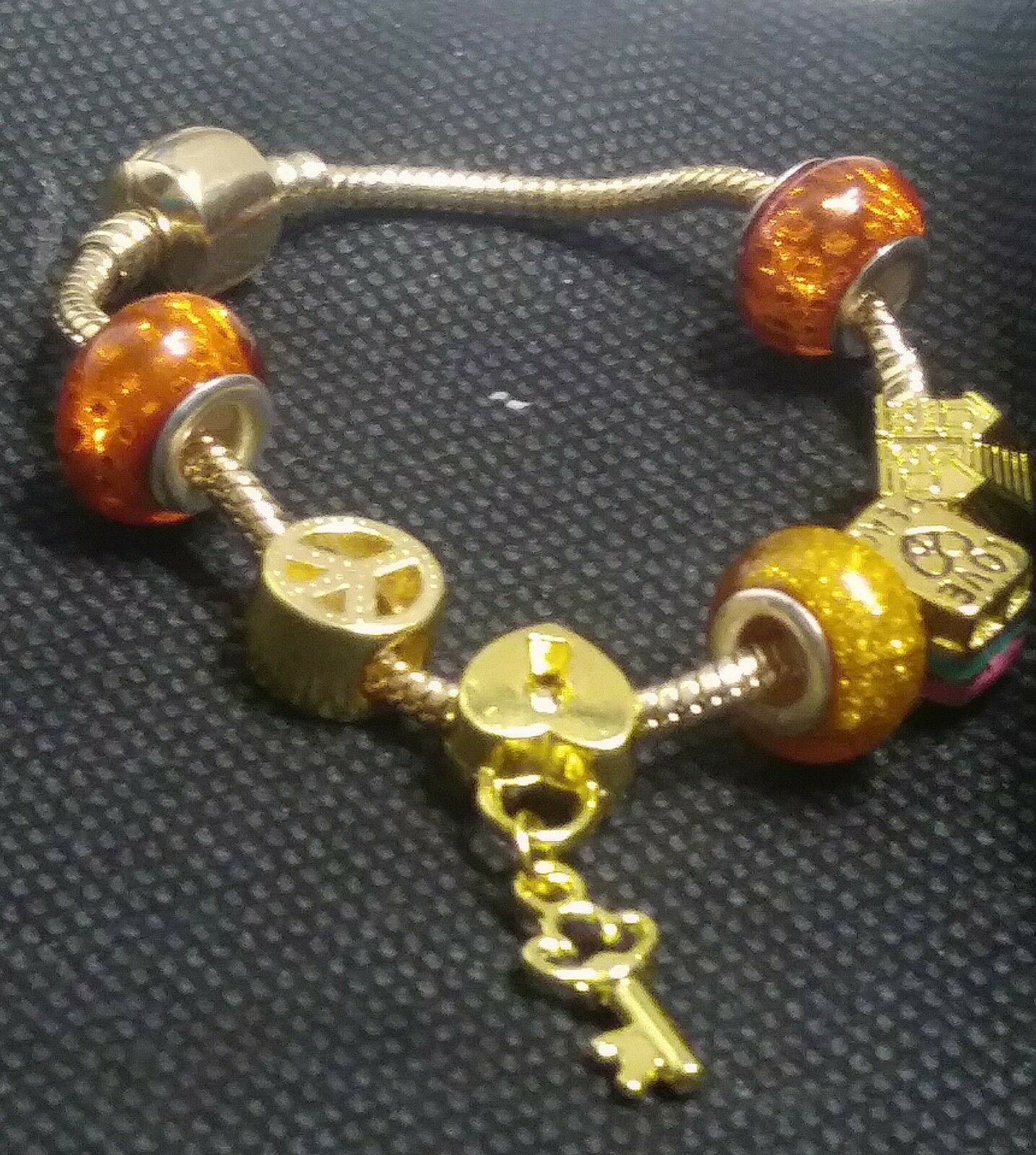 gold plated Euro bracelet and gold charms
