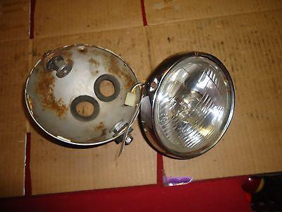 1975 ? suzuki tc 125    head light     used part look