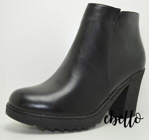 Tronchetti-donna-tacco-medio-stivaletti-di-colore-nero-decollte-eleganti-con-zip