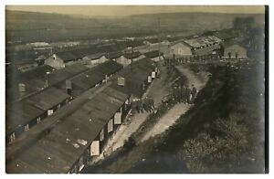 Antique-WW1-military-RPPC-postcard-extensive-army-camp-view-soldiers-amp-huts